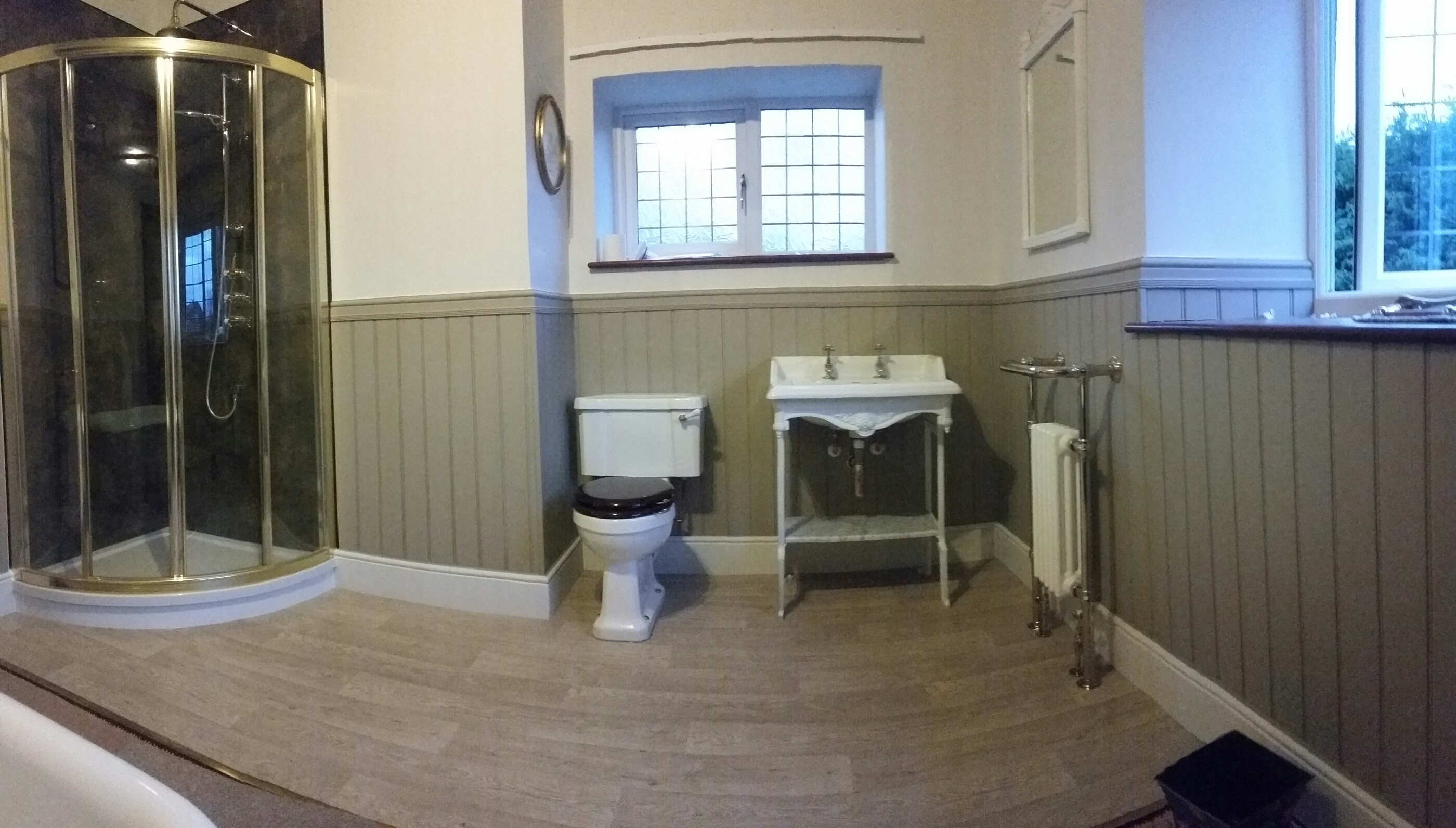 Traditional bathroom in an old cottage wood paneling with for Wood panelling bathroom ideas